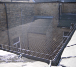 Bird control netting installed over courtyard area