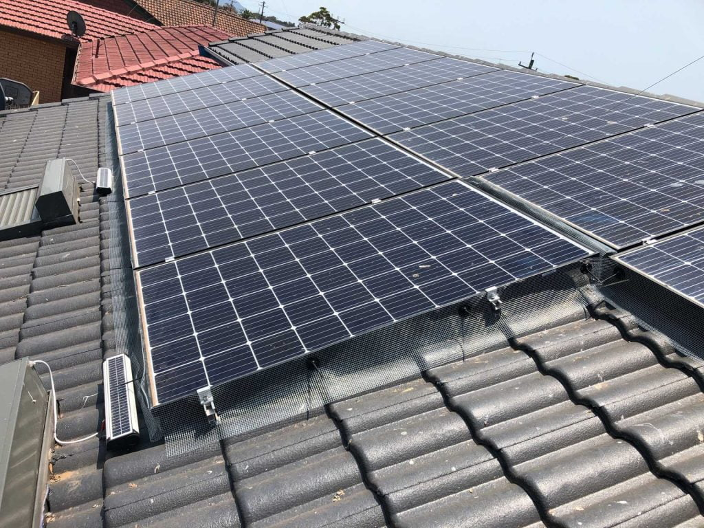 Mesh solar panel bird proofing on the tiled roof of a Wollongong home
